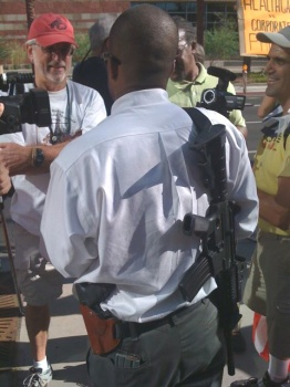 Black man armed with a AR-15 and Glock handgun at Obama protest in Phoenix